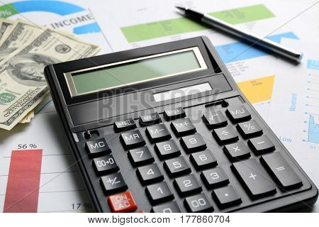 Tax concept. Calculator and money on table