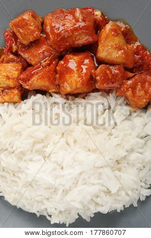 Plate with delicious chicken tikka masala and rice, closeup