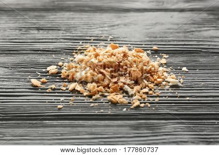 Bread crumbs on wooden table