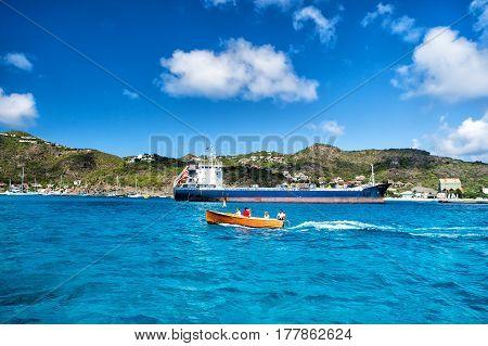 People In Boat, Big Cargo Ship, French Island, Saint Barthélemy