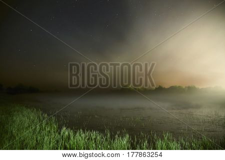 The night the starry  tranquil sky. Night Photography. Astrophotography. Dense fog over the lake. The surface of the water. Tranquil landscape