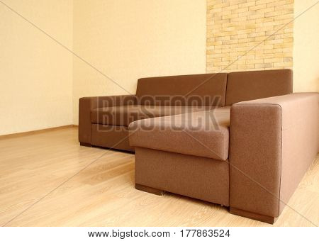 Large brown sofa in modern living room