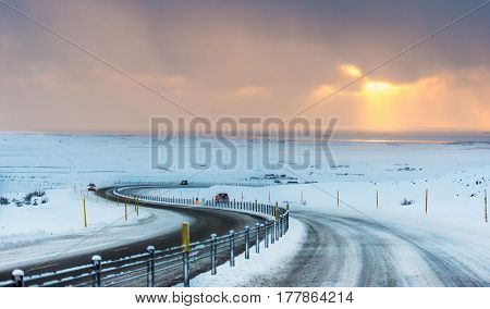 S curved long road Iceland driving in winter condition