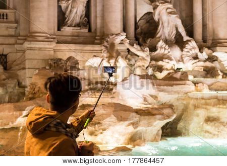 Tourist Taking Picture Of Trevi Fountain
