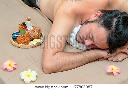 Asian Man Having A Relaxing Time In Beauty Spa