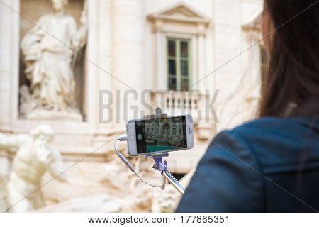 Taking A Photo Of Fontana Di Trevi