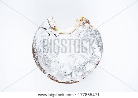 Easter glased cupcake isolated over white. Bited off a piece. Top view