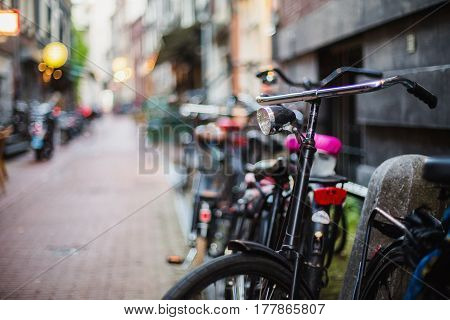 A stroll through the streets of Amsterdam. Bicycles on a city street. Travel through Europe. Ecological trasport.