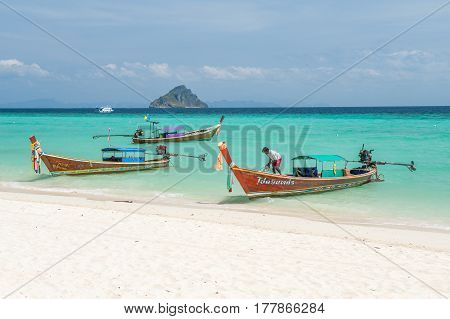 PHI PHI ISLANDS, THAILAND - FEBRUARY 22: Longtail boats at Laem Tong Beach on Phi Phi Islands. Phi Phi Islands are a popular tour destination from Phuket and Krabi.