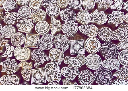 Carved symbols leaves sun sea fish on wooden surface of mold blocks for traditional printing textile. Popular design in India