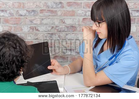 female doctor explaining x-ray results to patient
