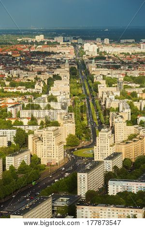 Travel to Germany. View of the building and streets of Berlin with a bird's-eye view. Overcast sky. Light from the sun on the building. Residential houses. Megapolis. European city