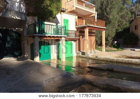 Fishing Village Cala Figuera Port With Boathouses And Green Gates, Majorca, Spain