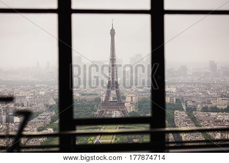 Eiffel Tower in Paris. View of the streets of Paris from the heights. Travel through Europe. Attractions in France. Cloudy Paris. Clouds in the sky. Eiffel Tower