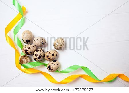 Easter eggs with colourfulll tapes on wood background Top view with tag for copy space