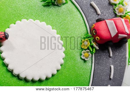 Delicious cake with ladybug and cars with free place for text close up.