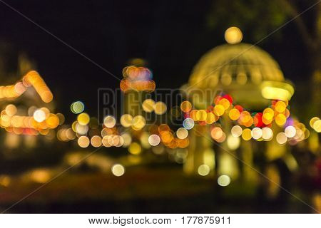 blur image of night festival on street blurred background with bokeh