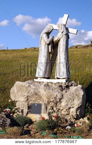 The Way of Jesus Christ: Veronica wipes the sweat from the forehead of Jesus Christ. (A statue on the Holy Mountain in the Ternopil region Ukraine)