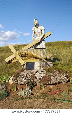 The Way of Jesus Christ: Jesus falls with the cross. (A statue on the Holy Mountain in the Ternopil region Ukraine)