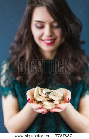 Young woman holding a lot of wooden usb sticks in hands
