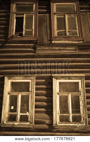Windows of the old wooden house black and white