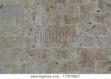 old stone wall backgound military fortress built of hewn stone