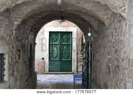 Old vintage door to the heme wall in an old paved street