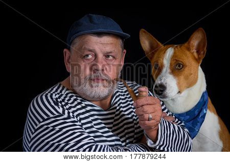 Portrait two friends - retired sailor and his cute dog