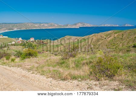Spring landscape with view from rocky road leading from Kara-dag natural reserve to settlement Kotebel on a Black Sea shore on Crimean peninsula