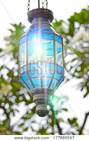 Decorative street lamp light glare a glass.