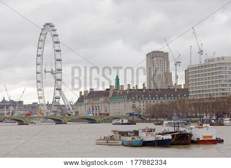 LONDON GREAT BRITAIN - FEB 27 2017: London Eye and the river Thames a cloudy day. February 27 2017 in London Great Britain