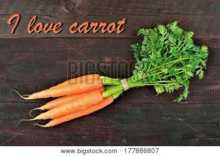 Fresh carrot packet on wood table background. Tasty and health product. Root vegetable