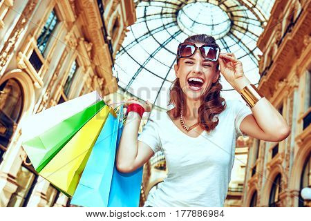 Smiling Woman With Shopping Bags In Galleria Vittorio Emanuele