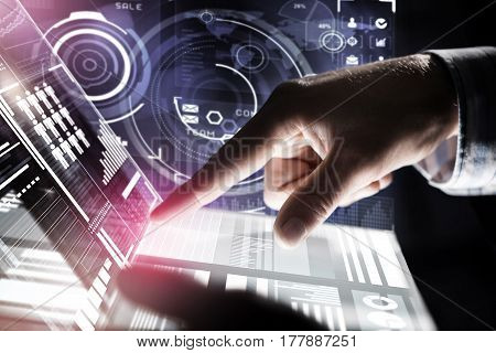 Businessman hand touching with finger virtual panel with infographs
