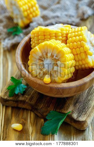 Pieces Of Corn Cob In A Wooden Bowl.