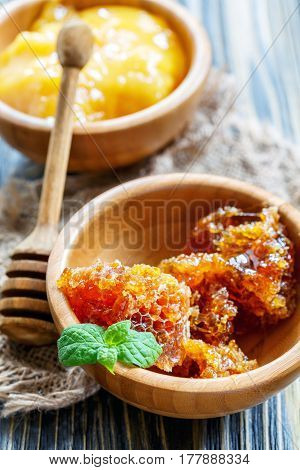 Flower Honey In A Wooden Bowls And Honey Dipper.