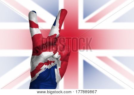 Hand Making Victory Sign, United Kingdom Painted With Flag As Symbol
