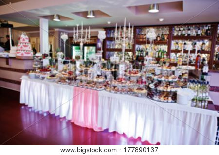 Blur Photo Of Wedding Reception Table At Restaurant.