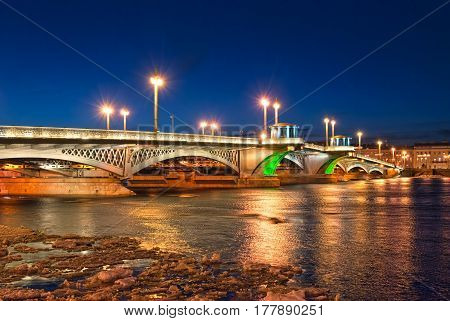 SAINT-PETERSBURG, RUSSIA, MARCH 23, 2017: View of The Blagoveshchensky (Annunciation) Bridge with colorful illumination over The Neva River. It connects the center of the city and Vasilievsky Island
