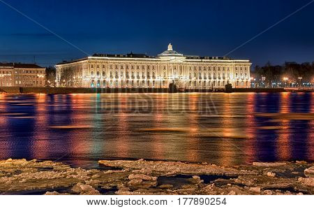 SAINT-PETERSBURG, RUSSIA, MARCH 23, 2017: Night view of The Russian Academy of Arts on the Universitetskaya Embankment and ancient Sphinxes near The Neva River