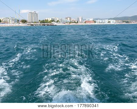 View from the stern of the yacht on retiring resort on the Black Sea