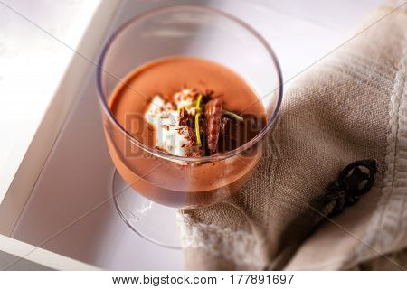 Chocolate Mousse Dessert with cream on a table