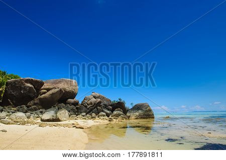Seychelles. Huge stones on the beach. Seascape view with a huge stones, blue sky.