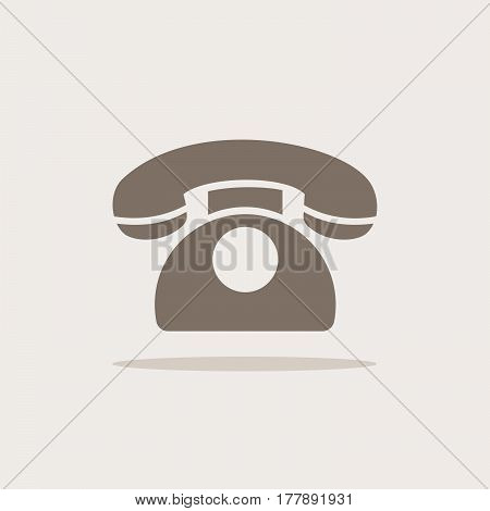 Classic phone icon with shadow on a beige background