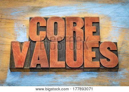 core values  banner  -  word abstract in vintage letterpress wood type blocks  against grunge wooden background