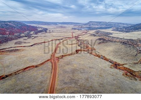 northern Colorado foothills aerial view with a network of dirt roads, dry streams and cattle walk paths*