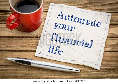 Automate your financial life advice - handwriting on a napkin with a cup of espresso coffee