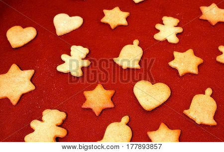 Gingerbread Christmas decoration cookies. Red festive background