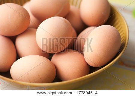 Many Boiled chicken eggs on brown plate