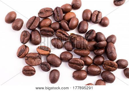 Many Coffee Beans In The Background. Texture Of The Coffee Beans On A White Background. Smelly, Satu
